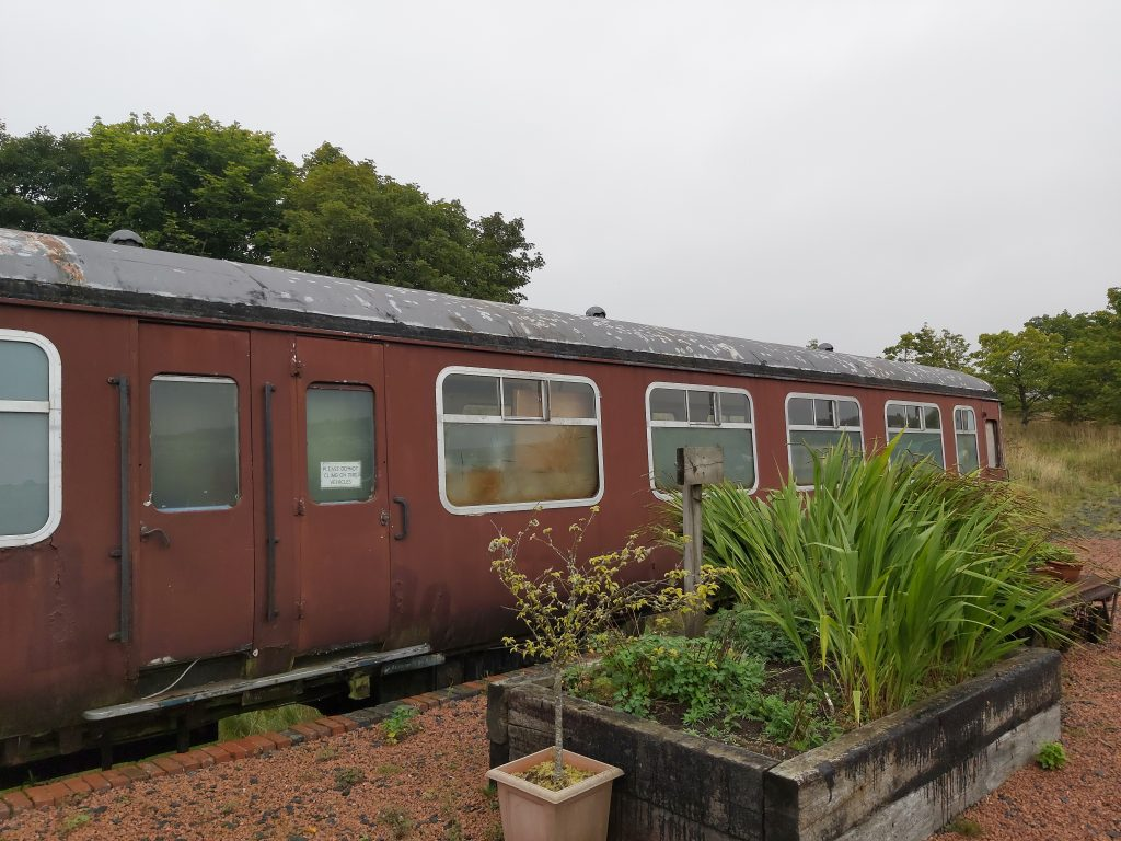 Rusty red coloured train carriage