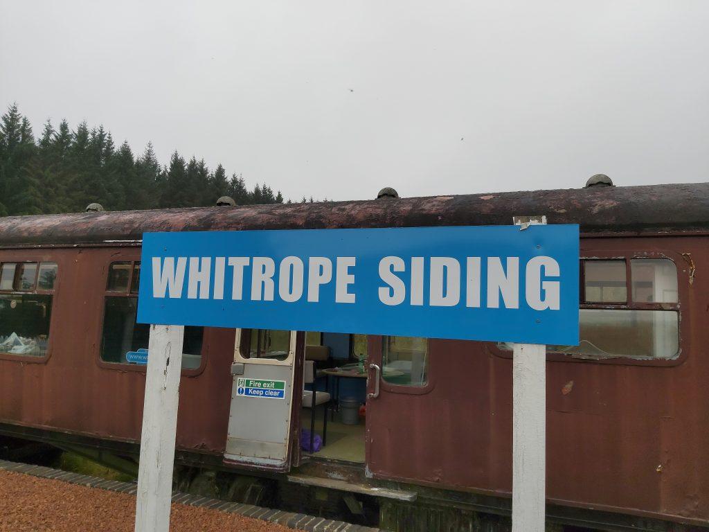 """""""Whitrope Siding"""" sign"""
