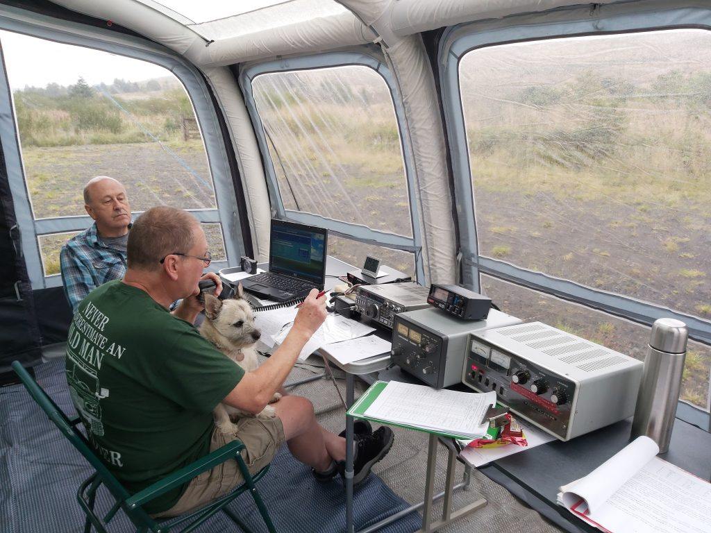Dave H MM0HTL operating with Buster on his lap, Dave S GM0KCN logging