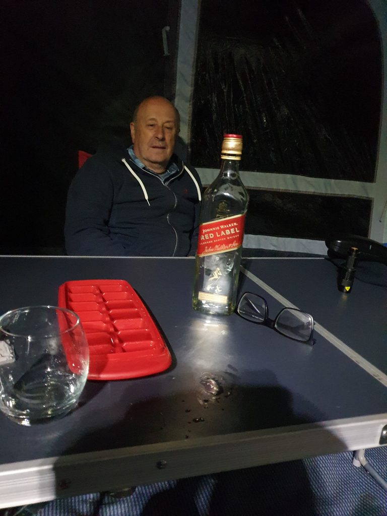 Dave S GM0KCN with bottle of Johnny Walker Red Label on table