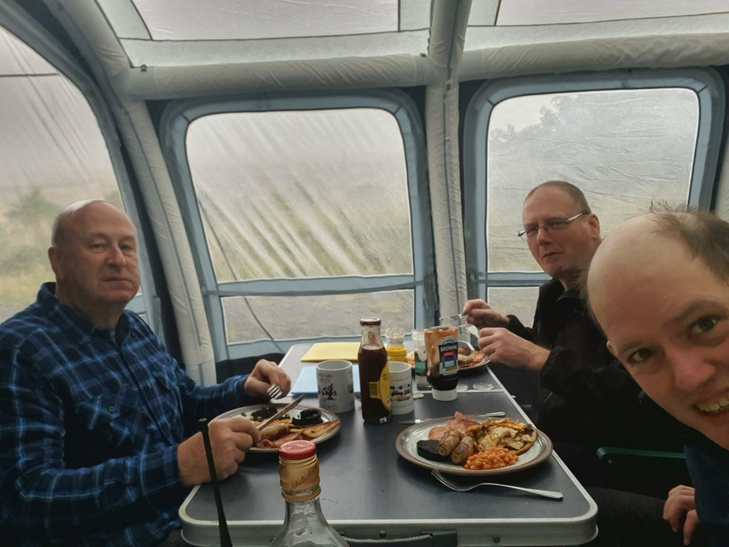Dave S GM0KCN, Dave H MM0HTL and Steven MM0ILC tucking into full English breakfast